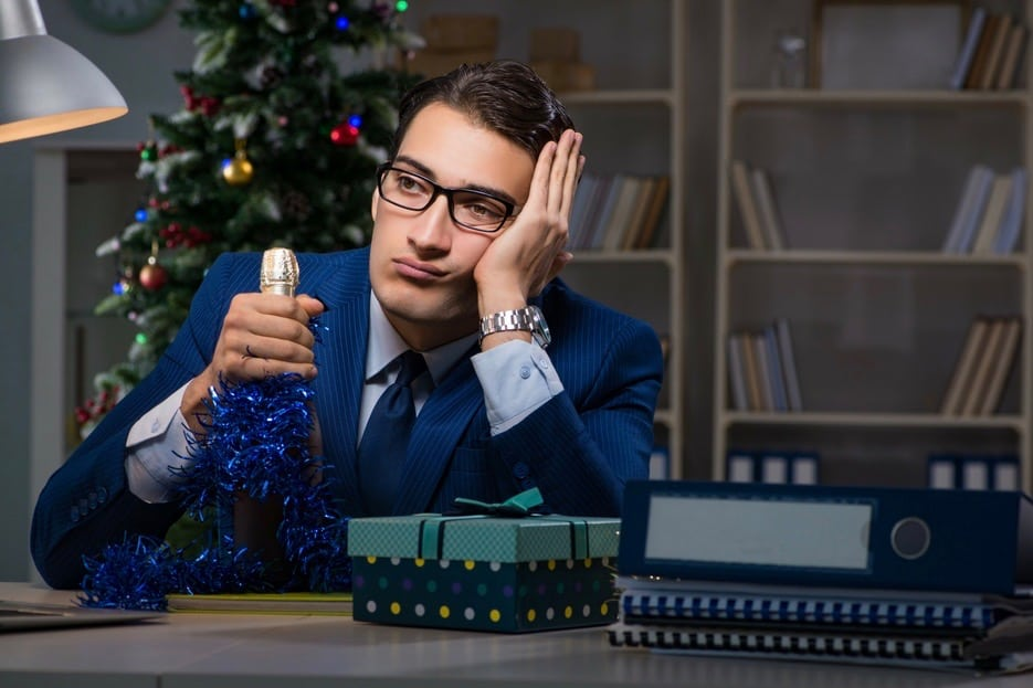 Man looking bored at holiday office party