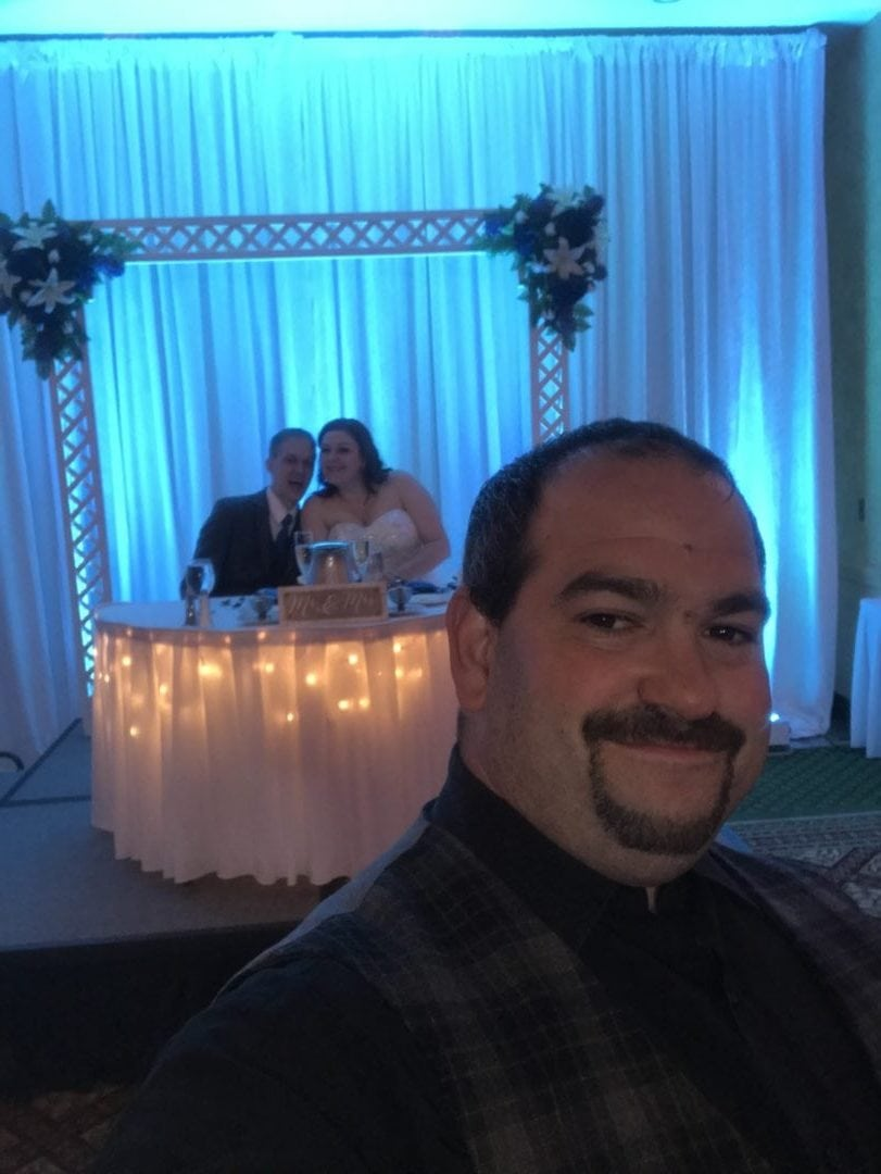 DJ selfie with bride and groom