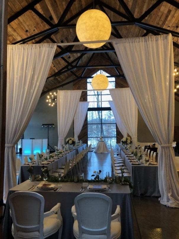 View of custom wedding drapery in a sheer light gray