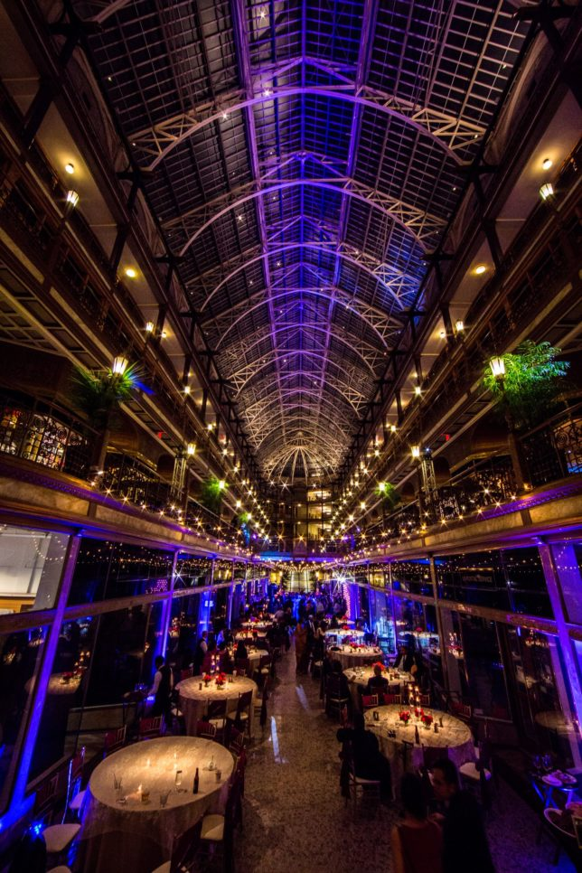 Cleveland Arcade with pin spotting on centerpieces, blue and amber lighting