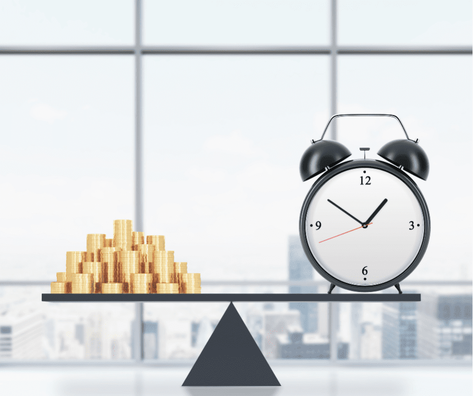 Gold coins and alarm clock on opposite ends of a scale