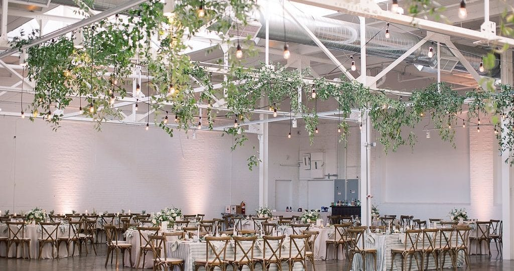 The Madison set up for wedding reception with hanging bistro lights and vines.