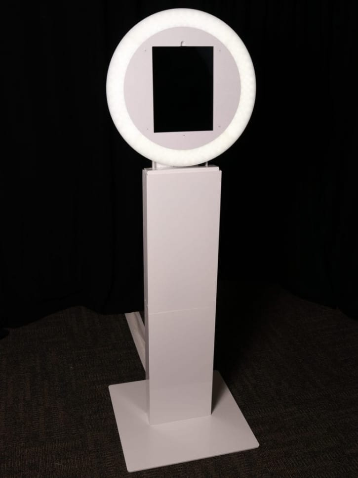 Picture of all white Aura photo kiosk