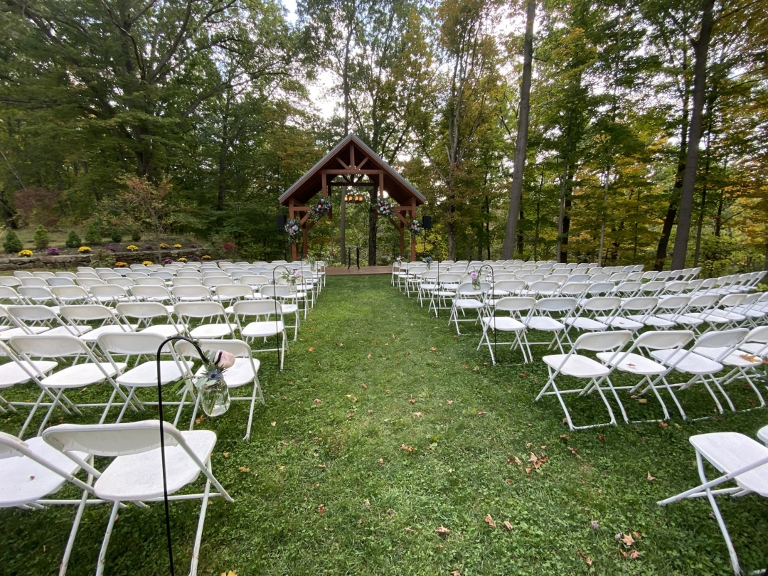 Empty chairs before beautiful outdoor ceremony