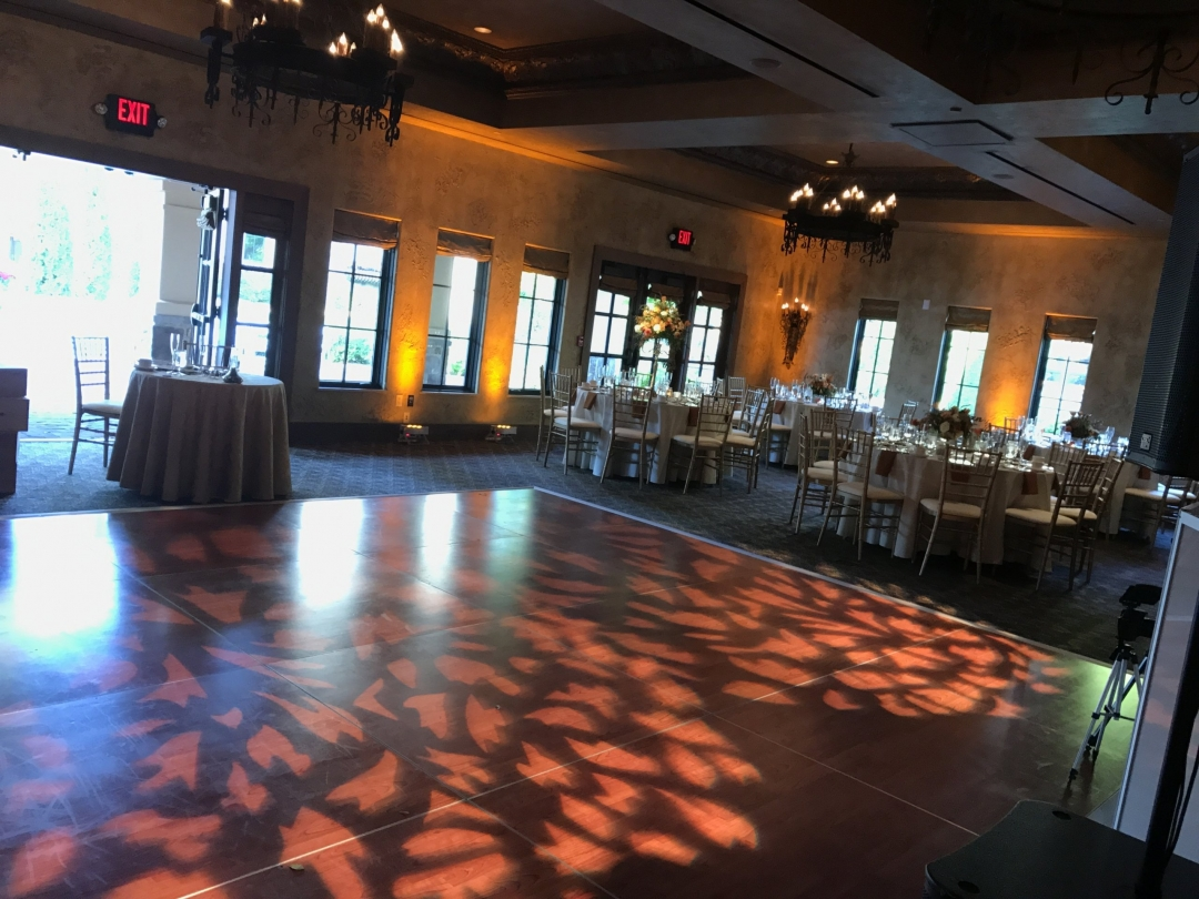 Wedding indoor ballroom with leaves on dance floor
