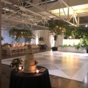 The Madison dance floor and cake photo with hanging floral chandeliers