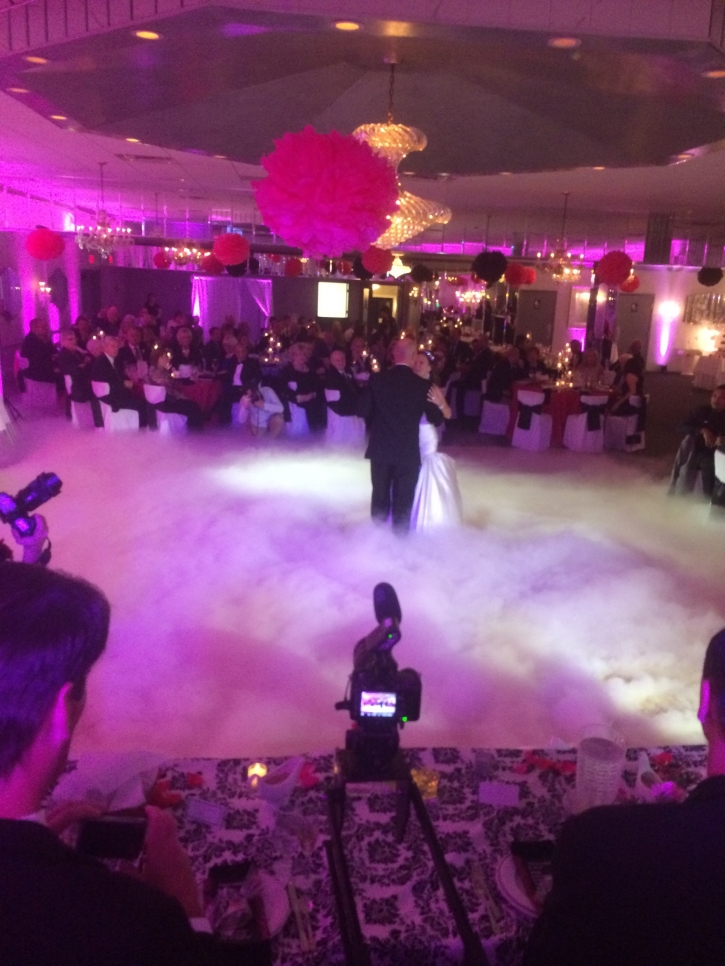 bride and groom dancing on the clouds