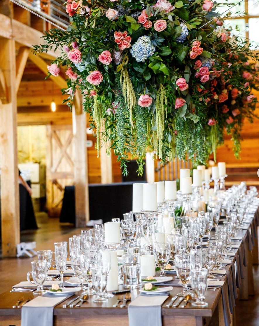 Floral hanging piece above head table at Mapleside Farm