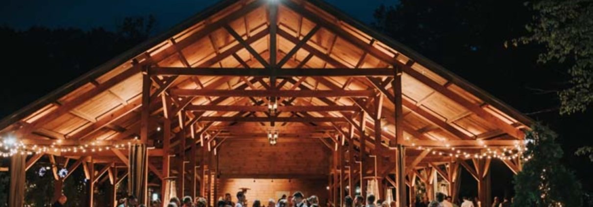 Front view of Meadow Ridge Farm wedding pavilion with people.