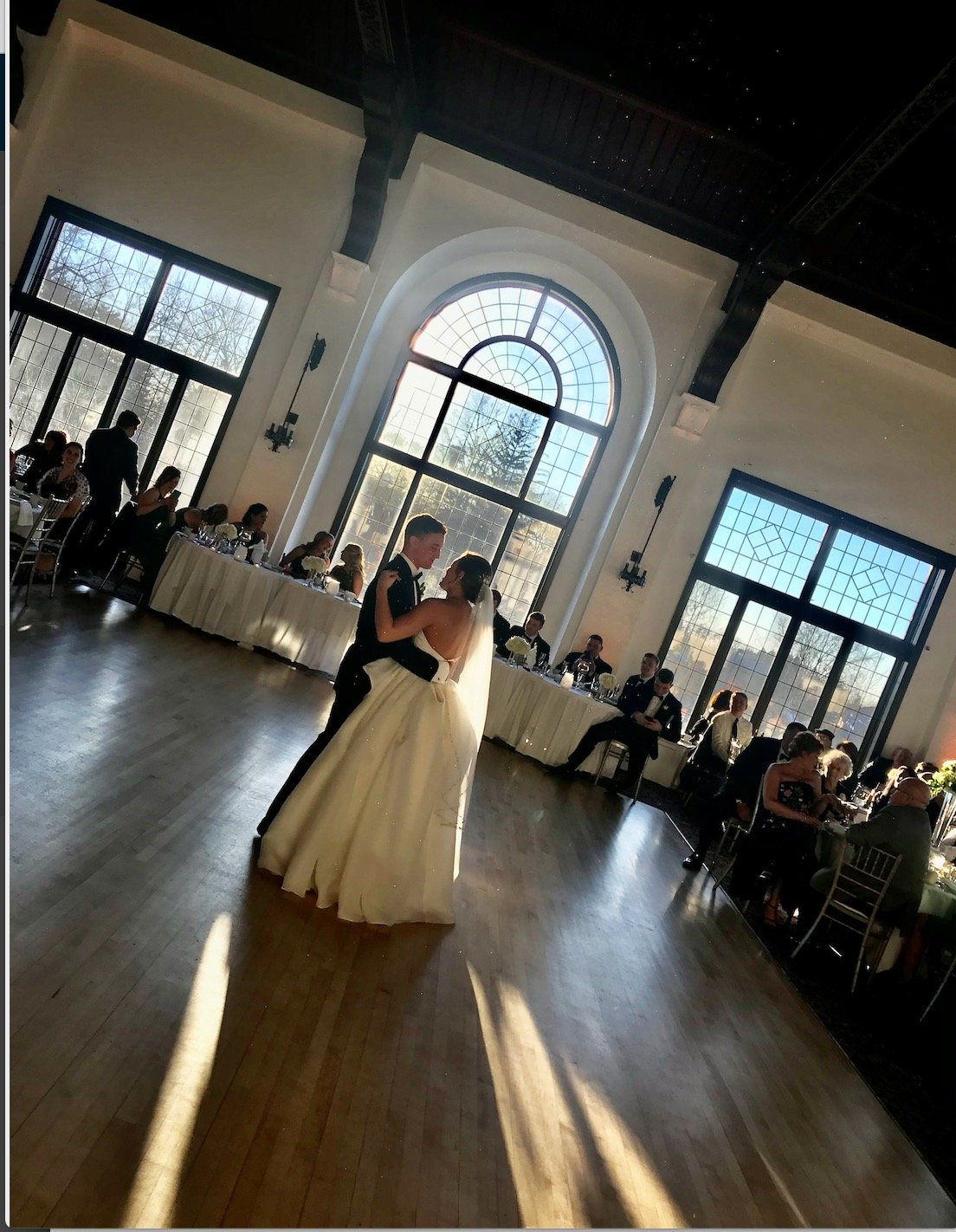 Bride and groom first dance at Pine Ridge Country Club wedding venue.