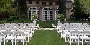 Ceremony set up at the Glidden House outdoors with white chairs