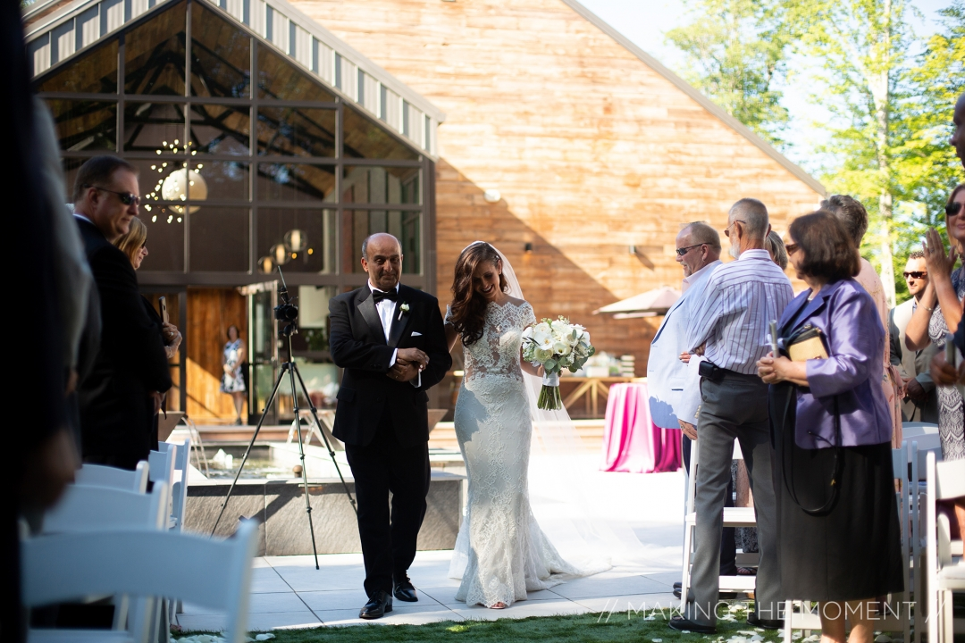Bride and father walking down isle at wedding ceremony