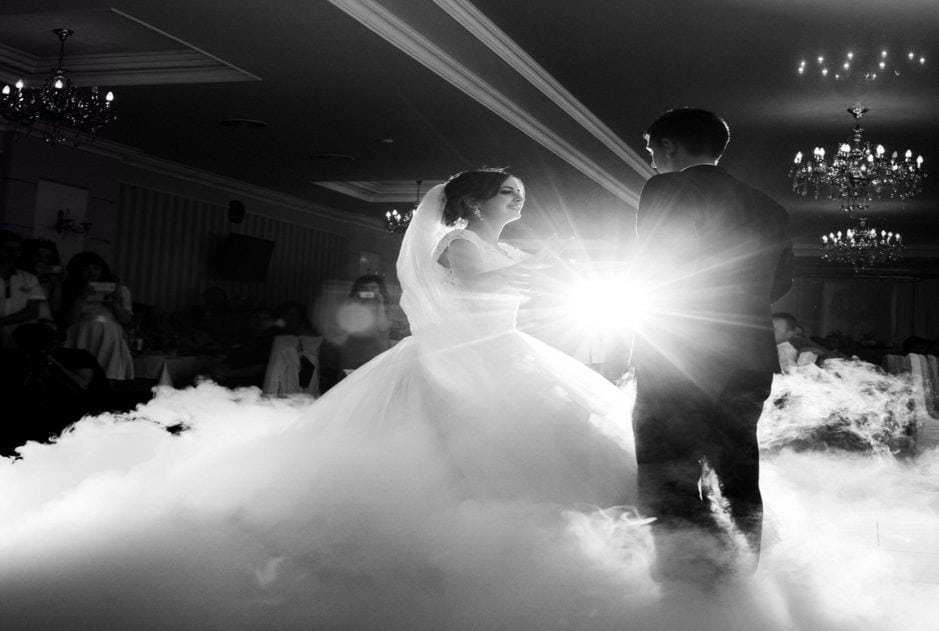 Black and white photo of bride and groom Dancing in the clouds