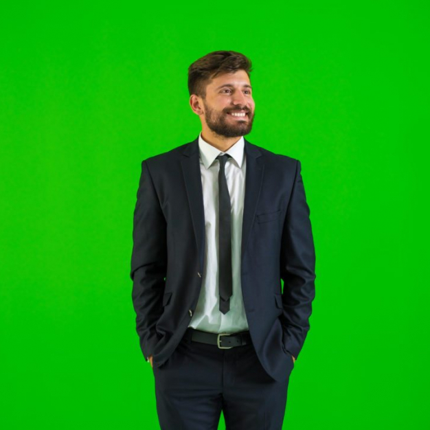 Man standing in front of a green screen photo booth