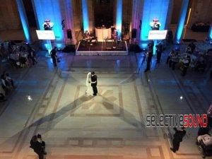 Feature spotlighting makes this couples first dance picture perfect