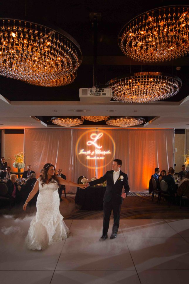 Bride and groom enjoy their first dance at their New Year's Eve wedding
