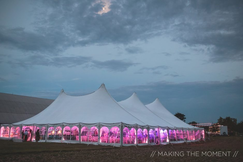 Outside view of pink Uplighting for wedding tent lighting