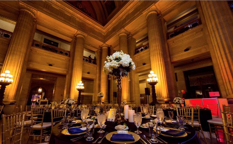 Guest table look gorgeous with amber uplighting at Cleveland City Hall Rotunda