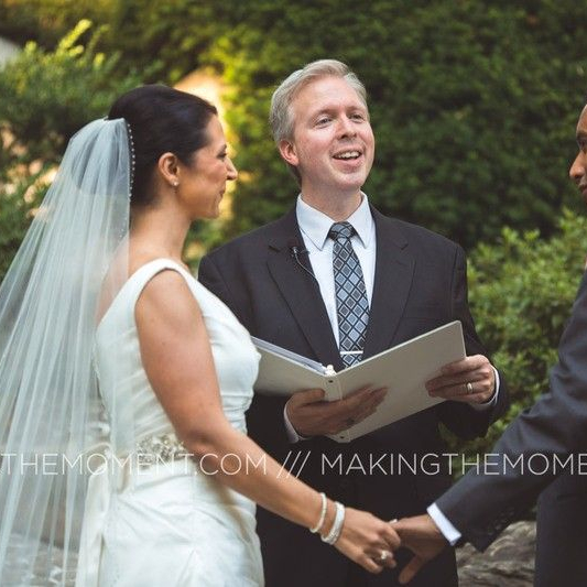 Bride, groom and officiant at ceremony using hidden lapel mics for wedding ceremony sound