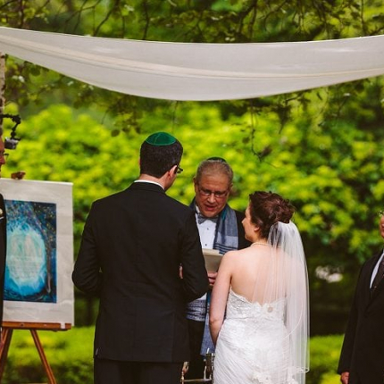 Wedding ceremony sound is completely hidden at this outdoor wedding ceremony
