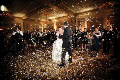 Bride and Groom enjoy confetti cannons during their first dance