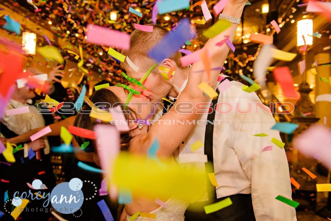 This kissing couples choice of wedding reception special effects was confetti cannons