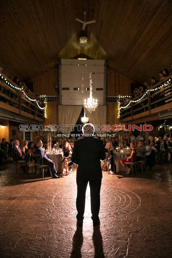 Father of the bride gives toast under feature spotlight