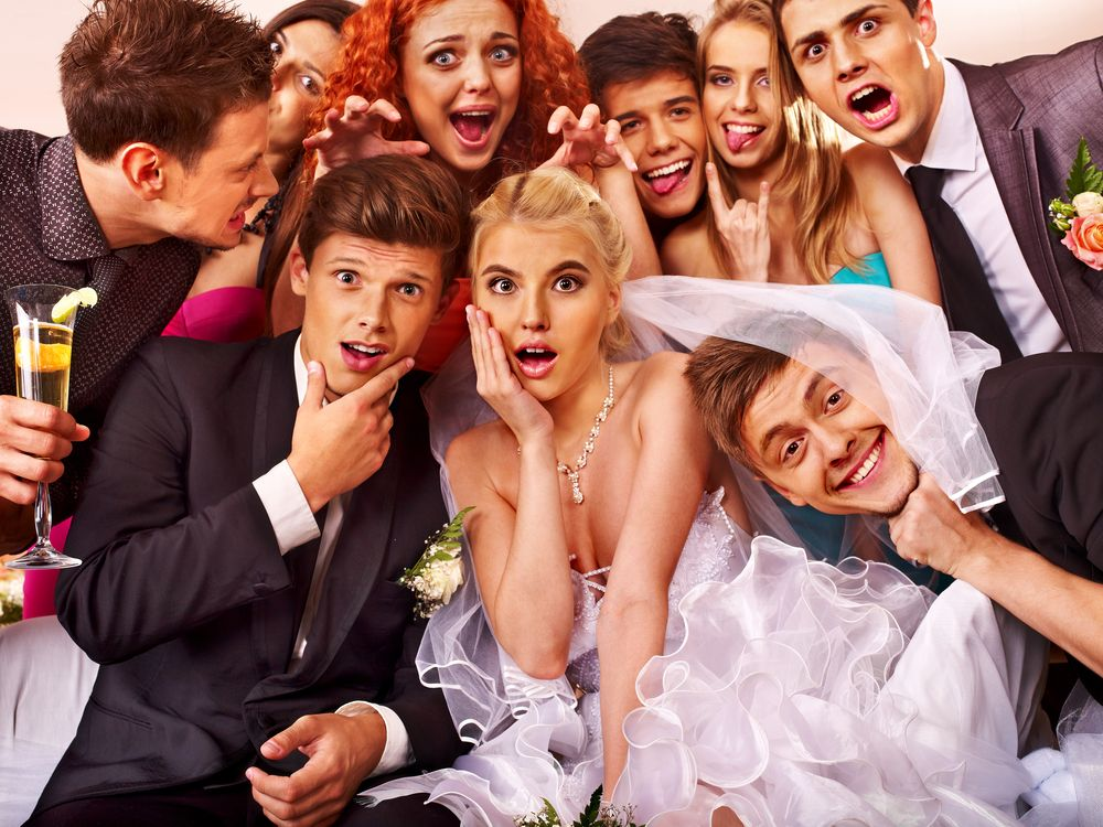 Bride, groom and 9 other people making funny faces inside Cleveland wedding photo booths top rated entertainment