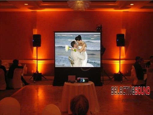 Wedding display screens like this projection screen can be used to view photos of the bride and groom.