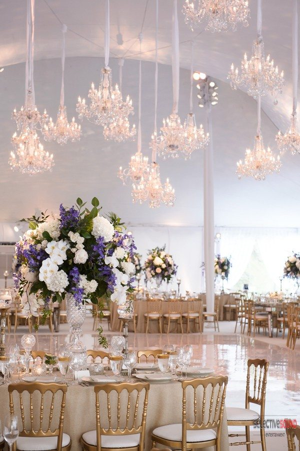 All white wedding with chandeliers used for wedding tent lighting