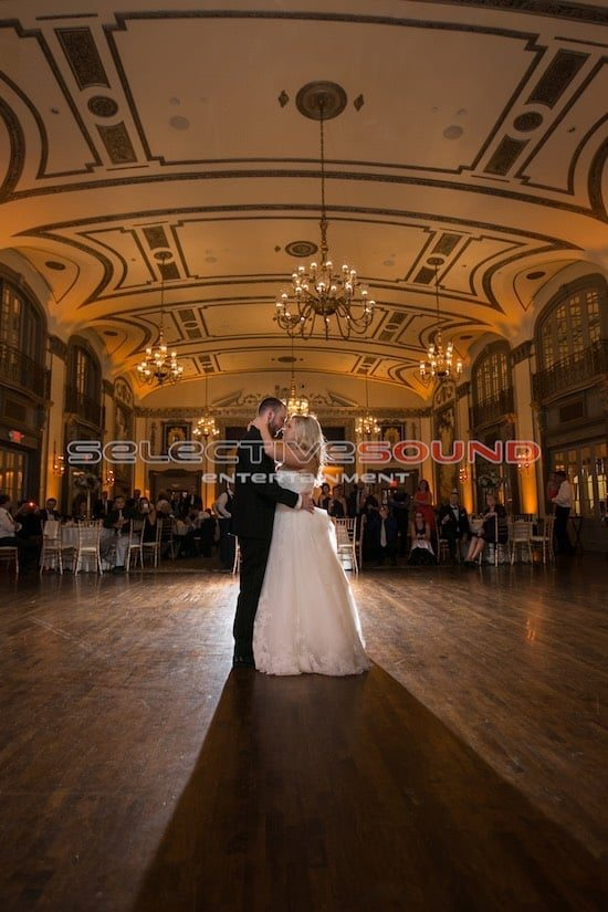 Bridge and groom first dance in warm wedding event lighting at Tudor Arms hotel.