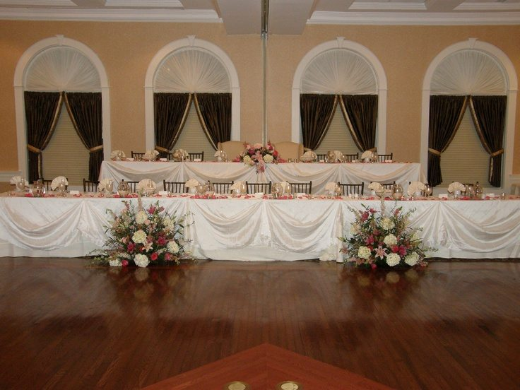 Wedding staging decks were used to create this 2 tiered head table.