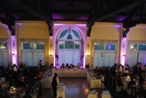 Pine Ridge country club lit up with lavender uplights behind head table