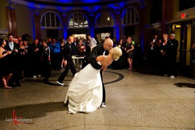 Bride and groom share a kiss on dance floor at The Ballroom at Park Lane Villa