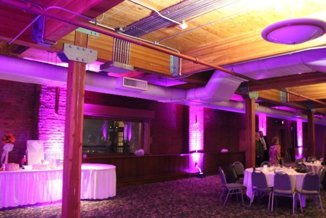 Wedding professionals dj s and lighting experts at windows on
