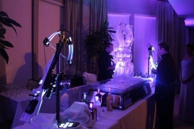 Wedding uplighting designers highlighted ice sculptures