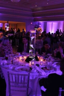 Wedding uplighting designers used pin spotting on centerpieces.