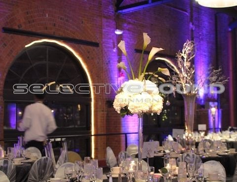 uplighting in bridgeview room with pin spotting on centerpiece