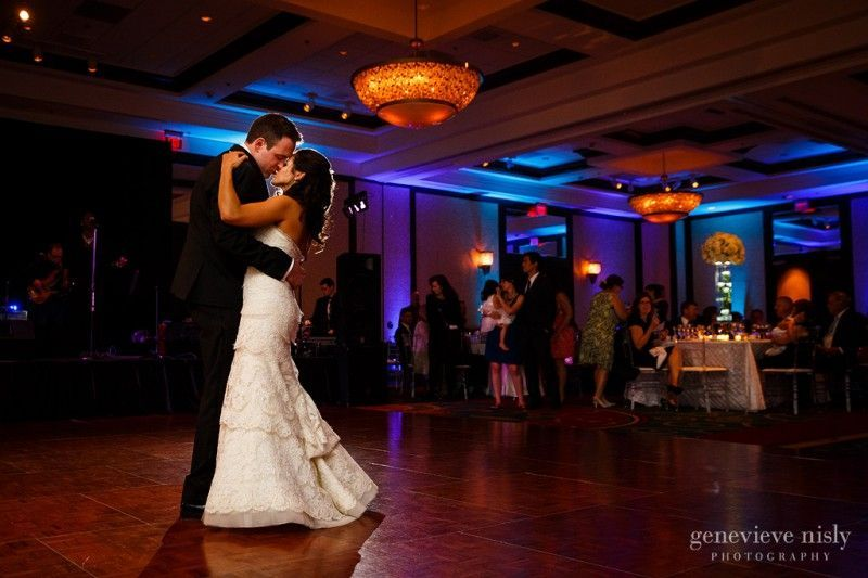 Bride and groom embrace in a kiss at their Cleveland Marriott wedding.