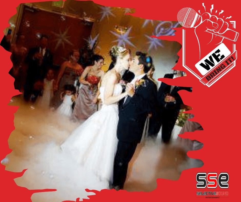 wedding couple's first dance under a spotlight, a great event trend to show off specific aspects at your event