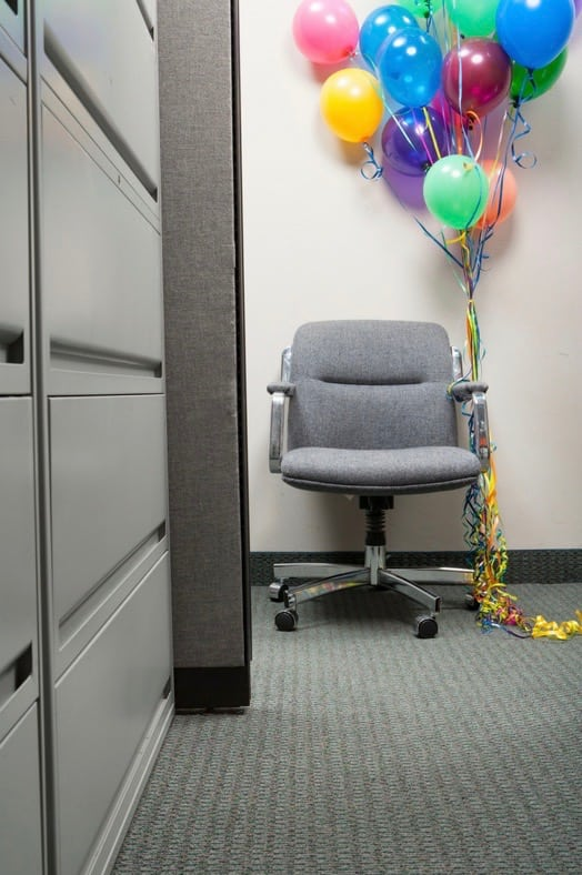 Office chair with balloons tied to it at Cleveland holiday party