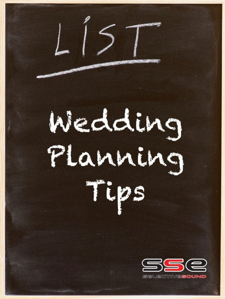 "Chalkboard with ""Wedding planning tips"" written on it."