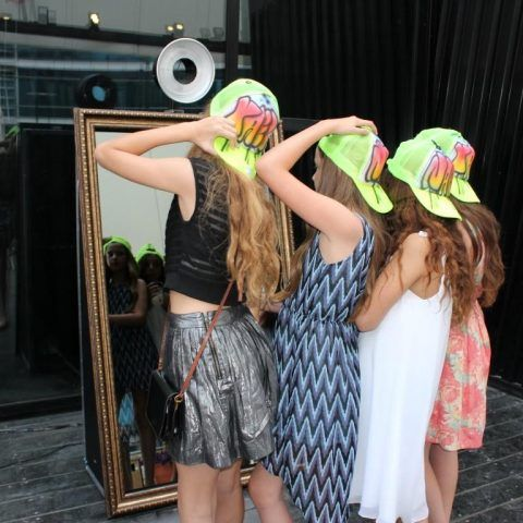 Girls Posing in the Mirror Photo Booth
