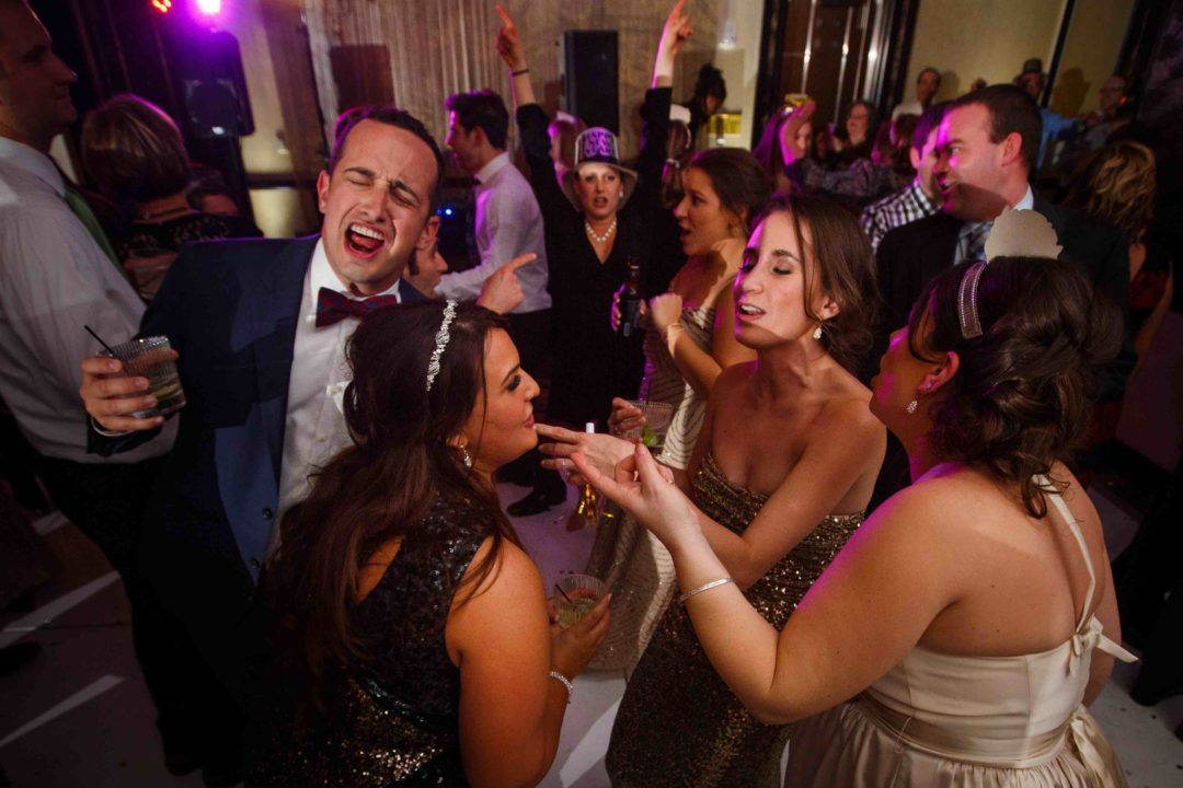 New Year's Eve wedding guests having fun