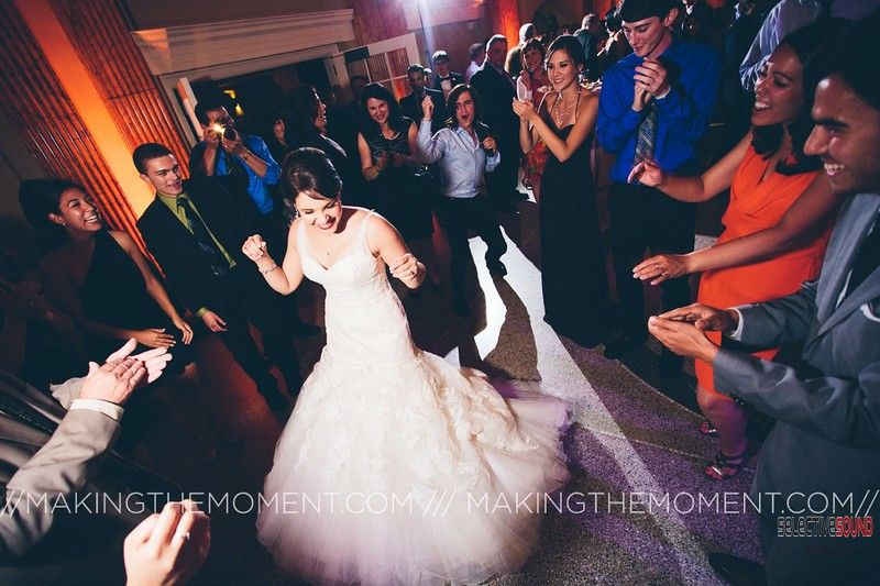 Bride dancing with guests surrounding her to music by a weddign DJ in Cleveland