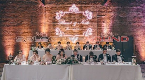 SSE Bridal Head Table with custom monogram at windows on the River