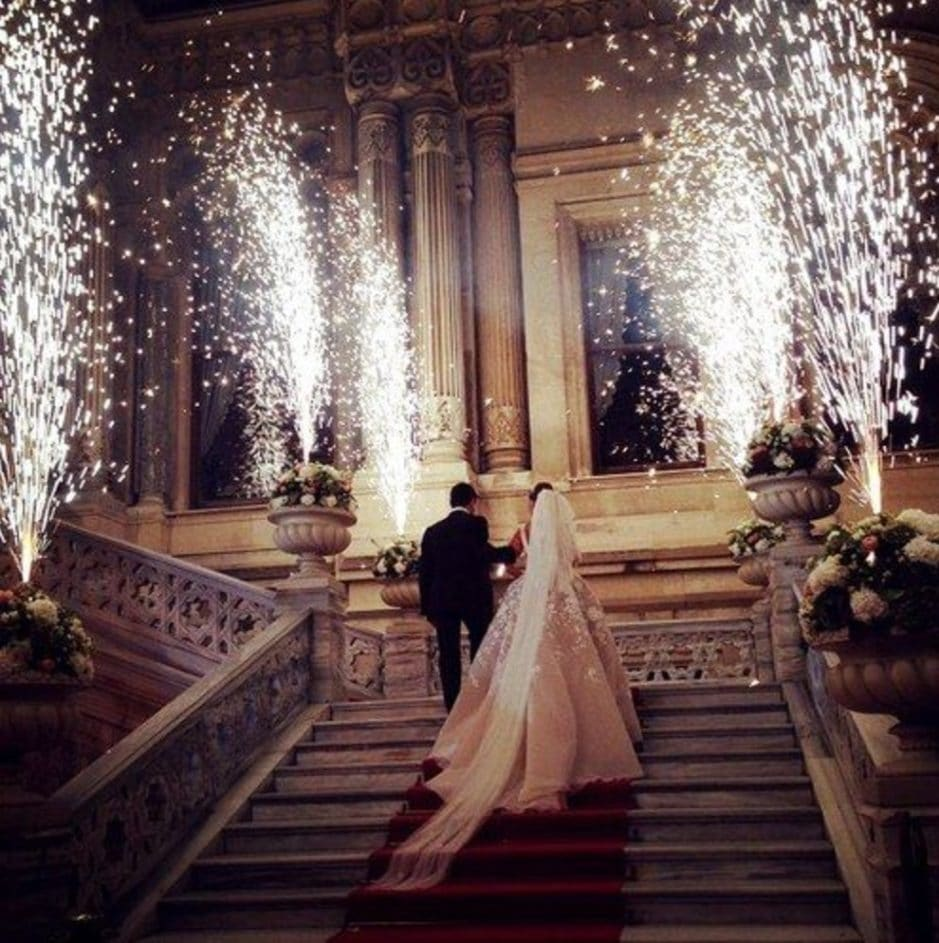 Grand entrance of bride and groom on stairs with sparks all around