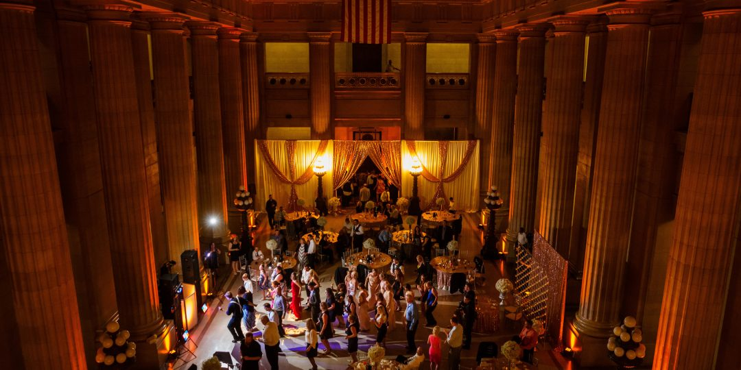 Guests doing line dance at reception in Cleveland City Hall Rotunda