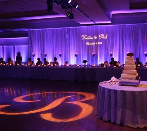 Signature of Solon C.C. with Custom Monograms/Gobos and lavender uplighting